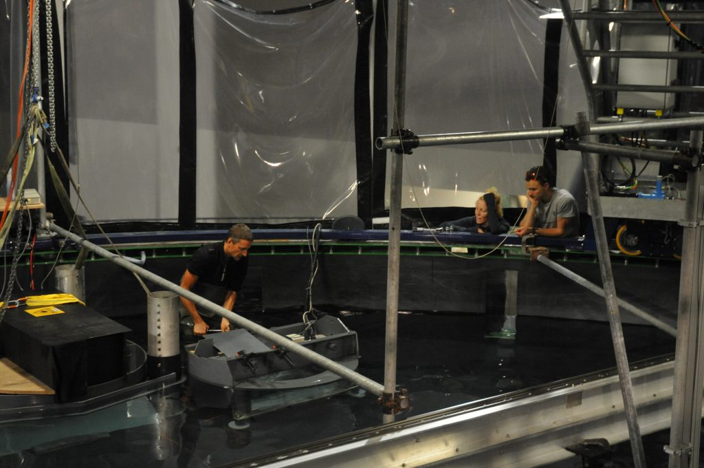 Elin and Thomas observing Samuel working on the laser