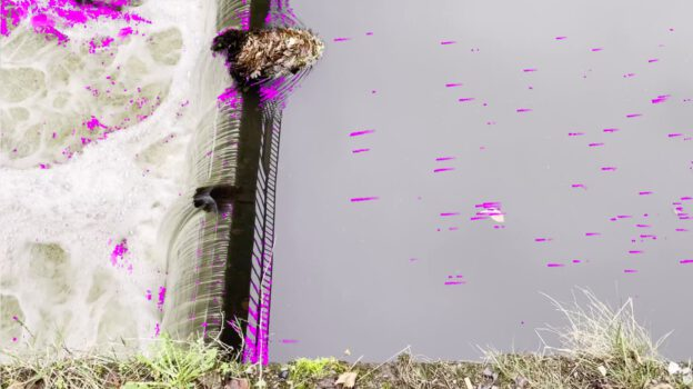 [annotated photo] Photo of water flowing over a weir, annotated with arrows showing particle velocities