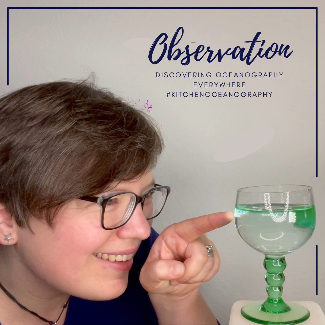 "[Photo and text] Mirjam @meermini pointing at a glass in which a green melt water layer is spreading from a green ice cube over clear water. The text says ""Observation. Discovering oceanography everywhere. #KitchenOceanography"""